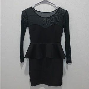 Black peplum dress by Charlotte Russe